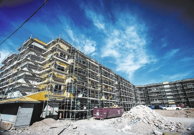 Construction at The Lennox  Las Vegas on Cactus Avenue near Bermuda Road  as seen on Monday, Feb. 17, 2014. Developers WGH Partners of Las Vegas and Florida East Coast Realty of Miami took over th ...