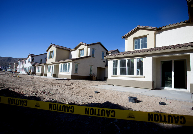 Construction at Elysian at Southern Highlands,12020 Southern Highlands Parkway, as seen on Monday, Feb. 17, 2014. The former DR Horton for-sale project that stalled in the recession and has been t ...