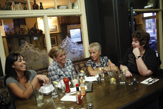 From left, Sonya Henney, Kim Chavez, Robin Henney and Peggy Compehos celebrate the life of Lawrence Compehos Jr. at Kavanaugh's Pub in Las Vegas June 16, 2012. Compehos died in 2008. (John Locher/ ...