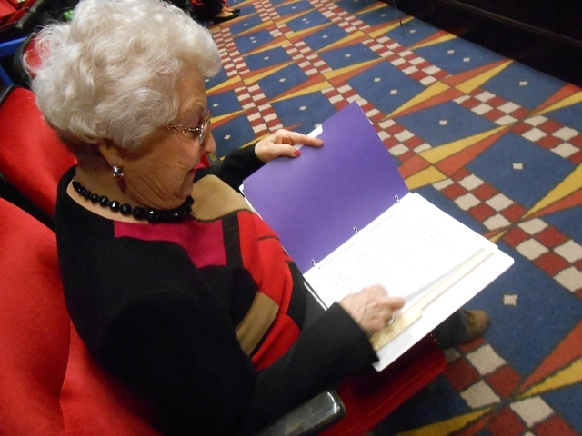Jeanne Cantor looks over the list of acts before directing the Sun City Community Theater at the Starbright Theatre, 2215 Thomas W. Ryan Blvd., Jan. 9. The group's originally planned next performa ...