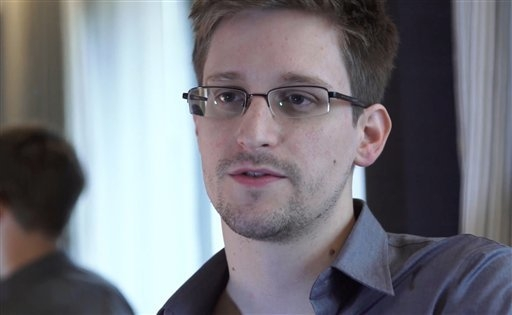 In this June 9, 2013, file photo provided by The Guardian Newspaper in London shows Edward Snowden, who worked as a contract employee at the National Security Agency, in Hong Kong. Compared with t ...
