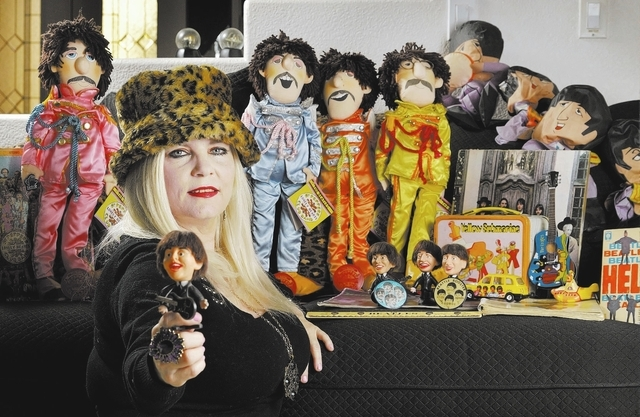 Sally Steele, editor and publisher of Vegas Rocks magazine, is shown with some of her Beatles memorabilia at her home near Bermuda Road and East Pyle Avenue on Thursday, Jan. 30, 2014. (Bill Hughe ...