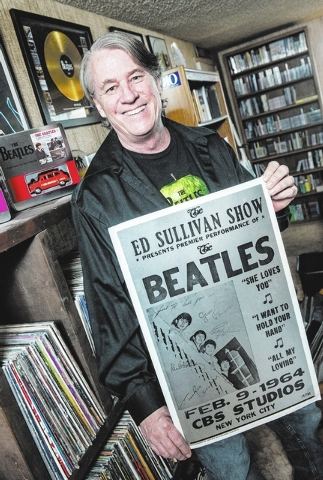 """Dennis Mitchell from the radio show """"Dennis Mitchell's Breakfast with the Beatles,"""" poses for a photo in his Las Vegas home on Thursday, Jan. 30, 2014. Mitchell became a fan of the Beatl ..."""