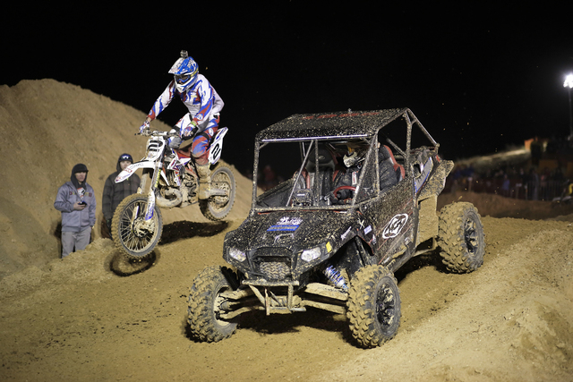 Motorcycle endurocross racer Cody Webb of Watsonville, Calif., and a four-wheel buggy with an unidentified driver race side by side on the Beyond Pro course during last year's Mesquite Off-Road  ...