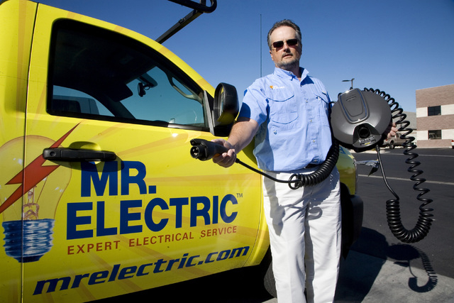 Andy Jackson, an electrical contractor and owner of Mr. Electric, holds a Voltec charging unit designed for the Chevy Volt electric-powered automobile. Jackson installs this unit and other brands  ...