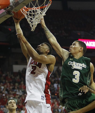 UNLV's Khem Birch (2) shoots past Colorado State's Marcus Holt (3) during their basketball game at the Thomas & Mack Center in Las Vegas on Feb. 26, 2014. (Jason Bean/Las Vegas Review-Journal)