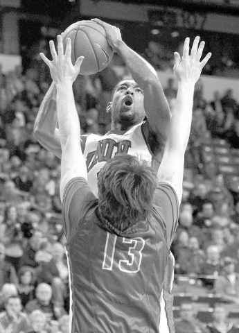 UNLV's Roscoe Smith (1) shoots over Boise State's Nicholas Duncan (13) during their basketball game at the Thomas & Mack Center in Las Vegas on Saturday, Feb. 1, 2014. (Jason Bean/Las Vegas Review ...