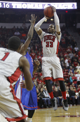 UNLV's Deville Smith shoots over Boise State's Derrick Marks (2) during their basketball game at the Thomas & Mack Center in Las Vegas on Saturday, Feb. 1, 2014. (Jason Bean/Las Vegas Review-Journal)