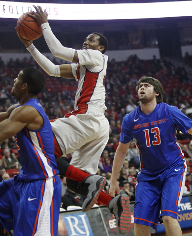 UNLV's Deville Smith shoots over Boise State's Derrick Marks (2) and Nicholas Duncan (13) during their basketball game at the Thomas & Mack Center in Las Vegas on Saturday, Feb. 1, 2014. (Jason Be ...