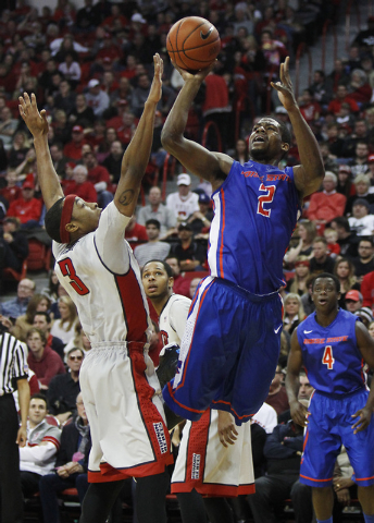 Boise State's Derrick Marks (2) shoots over UNLV's Kevin Olekaibe (3) during their basketball game at the Thomas & Mack Center in Las Vegas on Saturday, Feb. 1, 2014. (Jason Bean/Las Vegas Review- ...