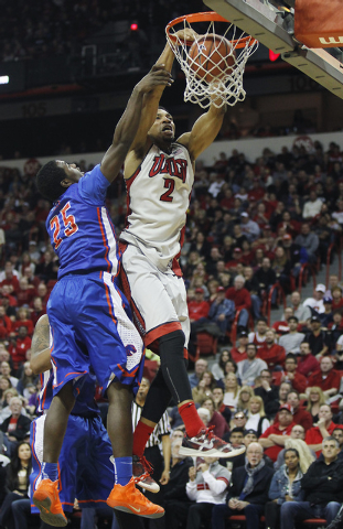 UNLV's Khem Birch (2) dunks over Boise State's Dezmyn Trent (25) during their basketball game at the Thomas & Mack Center in Las Vegas on Saturday, Feb. 1, 2014. (Jason Bean/Las Vegas Review-Journal)