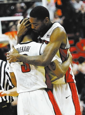 UNLV's Roscoe Smith (1) embraces his teammate Kevin Olekaibe (3) after he hit a go ahead three point shot over Boise State during their basketball game at the Thomas & Mack Center in Las Vegas on  ...