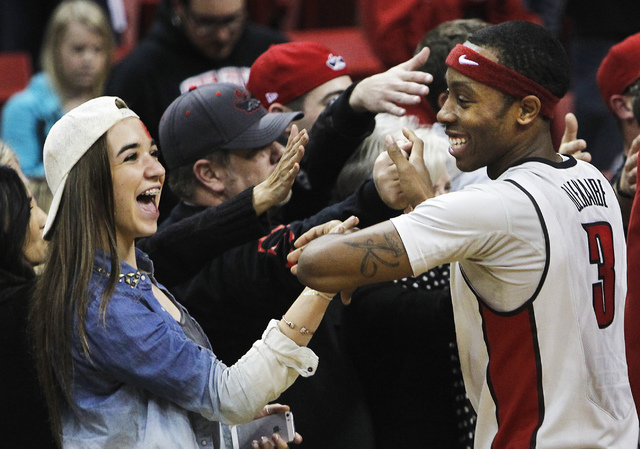 UNLV's Kevin Olekaibe (3) gets congratulated by the fans after his three point shot helped seal the victory over Boise State following their basketball game at the Thomas & Mack Center in Las Vega ...