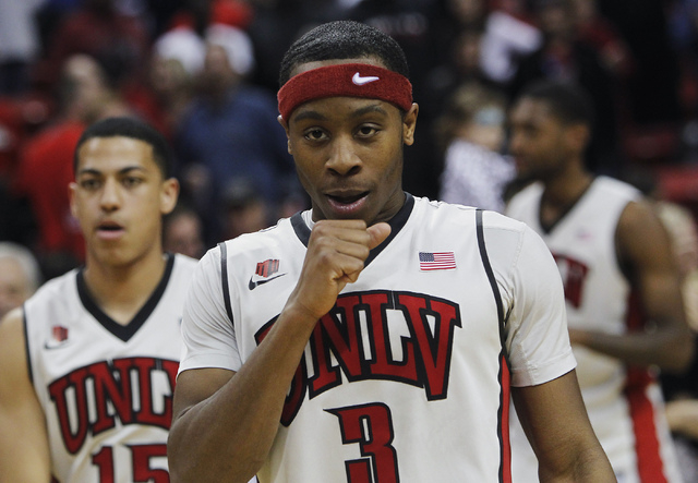 UNLV's Kevin Olekaibe (3) walks off the court after his three point shot helped seal the victory over Boise State following their basketball game at the Thomas & Mack Center in Las Vegas on Saturd ...