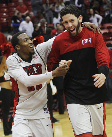 UNLV's Deville Smith, left, and Carlos Lopez-Sosa celebrate their team's come from behind victory over Boise State following their basketball game at the Thomas & Mack Center in Las Vegas on Satur ...