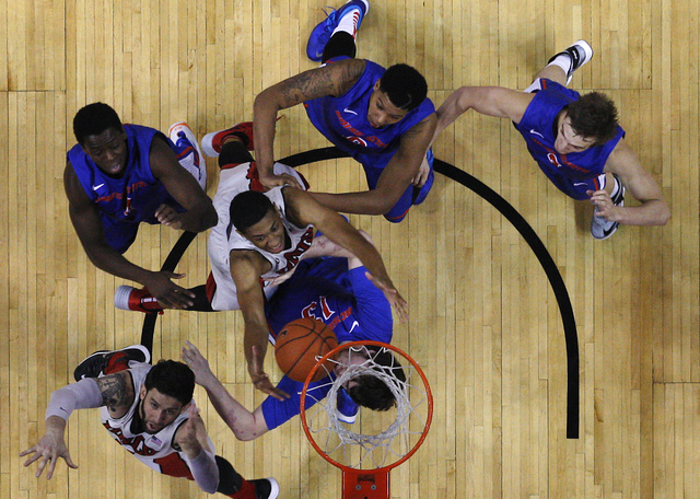 UNLV's Christian Wood (5) and Carlos Lopez-Sosa (11) battle for a rebound against Boise State's Nicholas Duncan (13), Thomas Bropleh (4), Ryan Watkins (0) and Anthony Drmic (3) during their basket ...