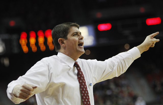 UNLV head coach Dave Rice yells instructions to his players as they take on Boise State at the Thomas & Mack Center in Las Vegas on Saturday, Feb. 1, 2014. (Jason Bean/Las Vegas Review-Journal)