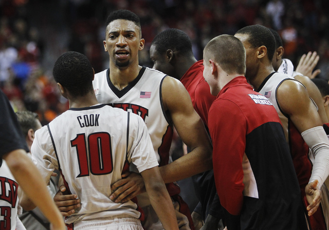 UNLV's Khem Birch (2) and Daquan Cook embrace during a time out against Boise State at the Thomas & Mack Center in Las Vegas on Saturday, Feb. 1, 2014. (Jason Bean/Las Vegas Review-Journal)