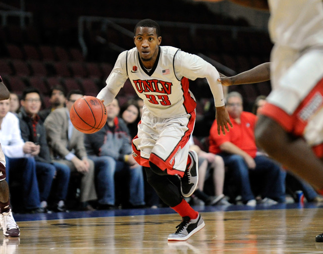 UNLV's Deville Smith drives the ball up court during the second half of a game at the Orleans Arena on Dec. 23. Smith was benched for the start of the Rebels last two games because of tardiness. ( ...