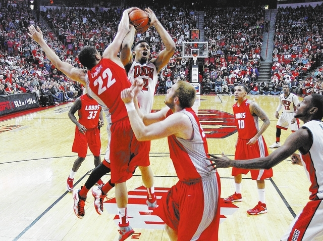 UNLV's Khem Birch (2) gets his shot blocked by New Mexico's Merv Lindsay (22) during their basketball game at the Thomas & Mack Center in Las Vegas on Wednesday, Feb. 19, 2014. (Jason Bean/Las Veg ...