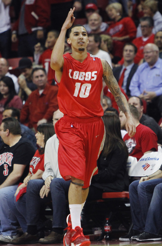 New Mexico's Kendall Williams (10) signals a three pointer while taking on UNLV during their basketball game at the Thomas & Mack Center in Las Vegas on Wednesday, Feb. 19, 2014. (Jason Bean/Las V ...