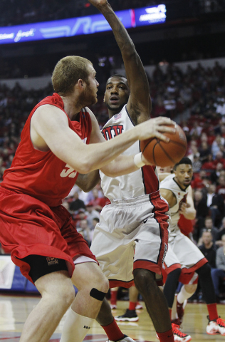 UNLV's Roscoe Smith (1) guards against New Mexico's Alex Kirk (53) during their basketball game at the Thomas & Mack Center in Las Vegas on Wednesday, Feb. 19, 2014. (Jason Bean/Las Vegas Review-J ...