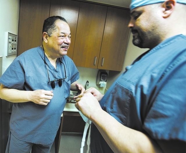 Plastic surgeon Dr. Carl Williams, talks to surgical assistant Robert Harvey before surgery on Tuesday, Feb. 4, 2014 at North Vista Hospital, 1409 East Lake Mead Boulevard in  North Las Vegas.  He ...