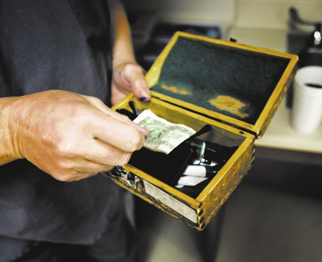 Plastic surgeon Dr. Carl Williams holds a dollar bill that he stores in his surgical microscope box on  Tuesday, Feb. 4, 2014 before surgery at North Vista Hospital, 1409 East Lake Mead Boulevard  ...