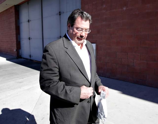 Las Vegas Constable John Bonaventura walks outside the Clark County Detention Center in Las Vegas moments after being released on Wednesday, Feb. 13, 2013. Bonaventura was arrested and charged wit ...
