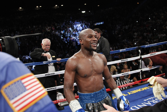 Floyd Mayweather celebrates after defeating Canelo Alvarez in their WBC and WBA super welterweight title bout at the MGM Grand in Las Vegas Sept. 14, 2013. Mayweather will next face Marcos Maidana ...
