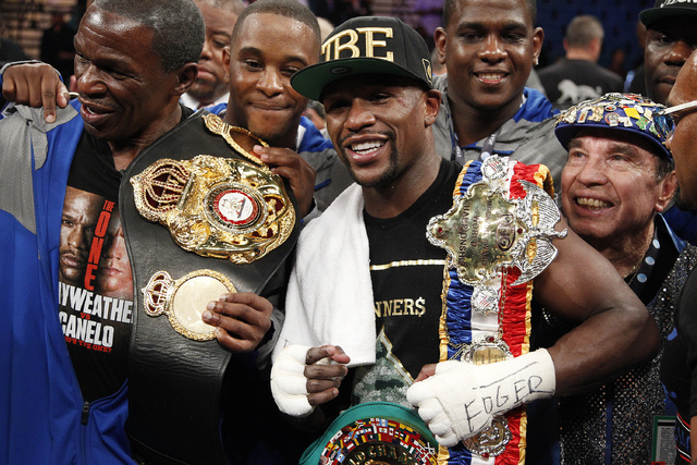 Floyd Mayweather celebrates after defeating Canelo Alvarez in their WBC and WBA super welterweight title bout at the MGM Grand in Las Vegas on Sept. 14, 2013. (John Locher/Las Vegas Review-Journal)