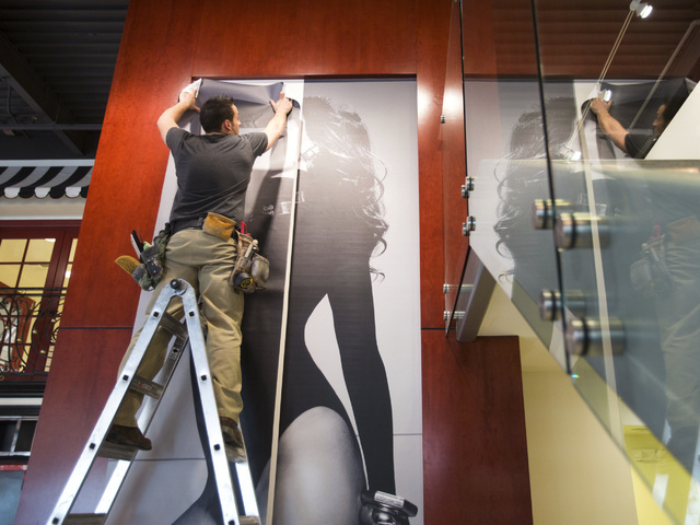 Bruce Fritts wallpapers a portrait of super-model Cindy Crawford at the Look Style Society, 6539 Las Vegas Boulevard South,  in Town Square on Friday, Feb. 14, 2014.  The beauty venue is scheduled ...