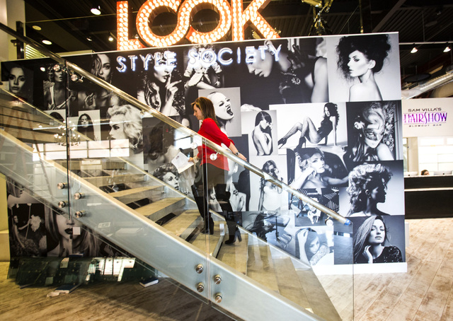 Kimberly Stuhmer, brand manager for Look Style Society, walks up the steps at Look Style Society, 6539 Las Vegas Boulevard South, in Town Square as seen Friday, Feb. 14, 2014.  The beauty venue is ...