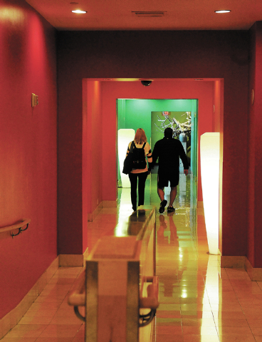 Two people walk down a hallway connecting the spa portion of Canyon Ranch Spa in the Palazzo hotel-casino to the exercise portion of the business in the Venetian hotel-casino in Las Vegas, Thursda ...