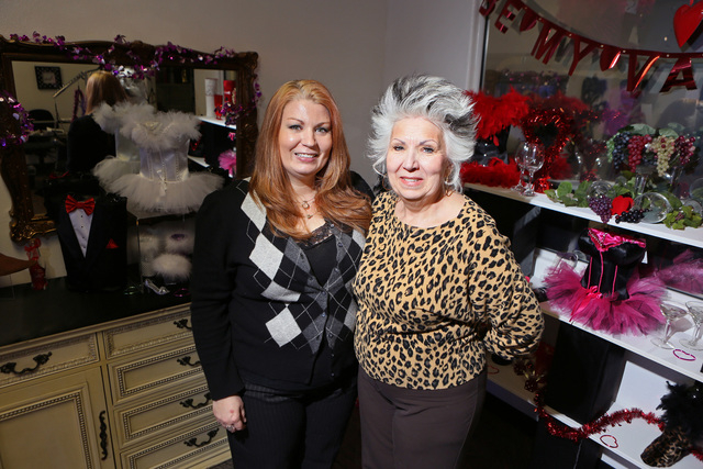 Ursula Bettendorf, left, and her mother Sonja stand near products displayed at their shop Trendy Tipsy Tuesday, Feb. 4, 2014, in Las Vegas. The duo started their business three years ago and sell  ...