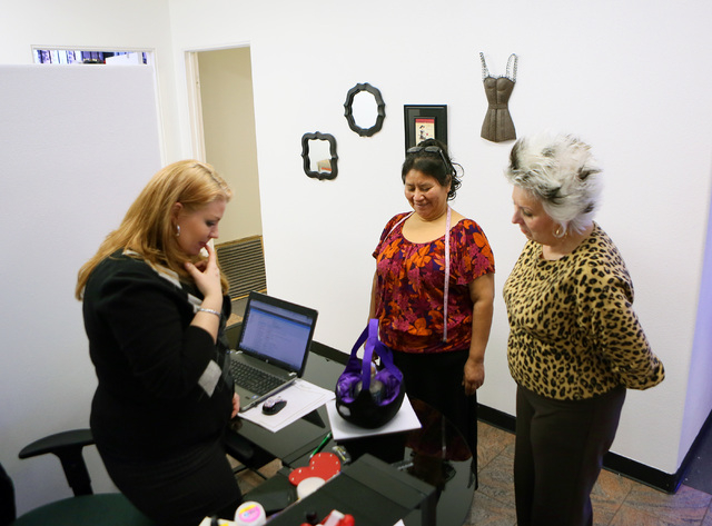 Ursula Bettendorf, from left, Juanita Chitay and Ursual's mother Sonja look over a work-in-progress at Trendy Tipsy Tuesday, Feb. 4, 2014, in Las Vegas. The Bettendorfs started their business thre ...