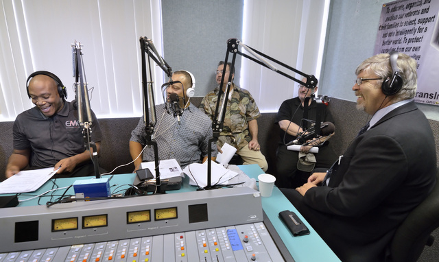 "Co-host Andre' Haynes, left, chuckles as host Steve Sanson, center microphone, listens during a lighter moment in an interview with Cliff Marcek on the ""Veterans in Politics"" show on vegasallnetra ..."