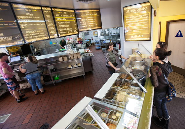 Kat Alvarez, center, takes orders from Sanisa, last name declined, in black, and Lins Otsukiza at Braddah's Island Style, 2330 S. Rainbow Blvd., in Las Vegas on Saturday, Feb. 15, 2014. (Chase Ste ...