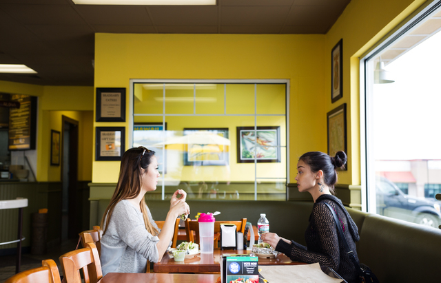 Lins Otsukiza, left, and Sanisa, last name declined, eat at Braddah's Island Style, 2330 S. Rainbow Blvd., in Las Vegas on Saturday, Feb. 15, 2014. (Chase Stevens/Las Vegas Review-Journal)