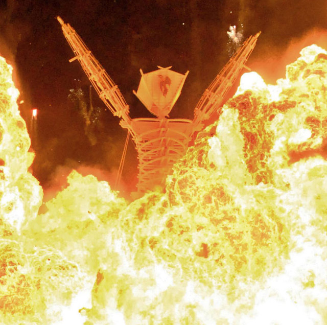 """A 4-foot wooden figure known as """"The Man"""" burns in the Black Rock Desert at the close of the Burning Man festival in 2007 in the Black Rock Desert near Gerlach. (AP Photo/Reno Gazette-Journal, And ..."""