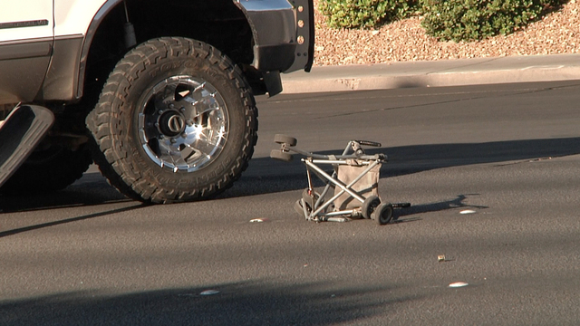 A child's stroller lies next to a pickup truck involved in an early morning traffic accident at Bonanza Road and Lamb Boulevard. Three children, ages 2, 4 and 5, and their father were injured when ...