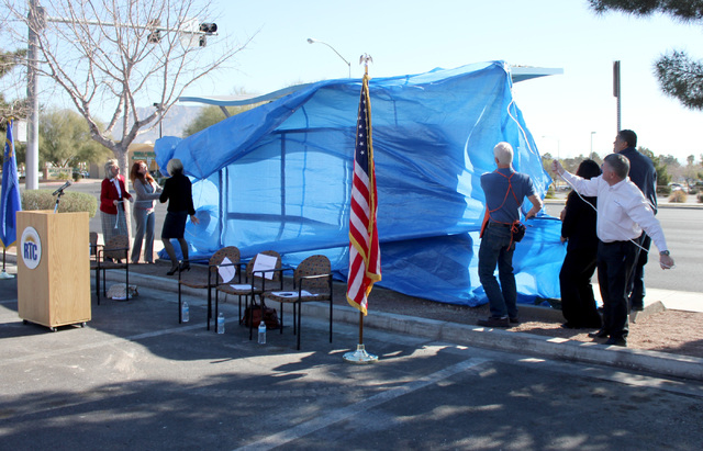 Nevada Rep. Dina Titus, Henderson Councilwoman Debra March and RTC general manager Tina Quigley unveil a renovated transit shelter Monday. To their right are representatives from companies that ha ...