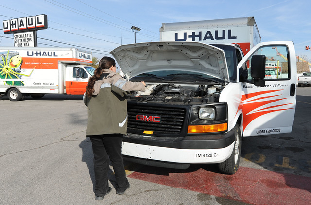 Roas Mendoza checks the oil in a rental truck at the U-Haul center at 2001 W. Bonanza Rd., in Las Vegas, Friday, Feb. 7, 2014. (Jerry Henkel/Las Vegas Review-Journal)
