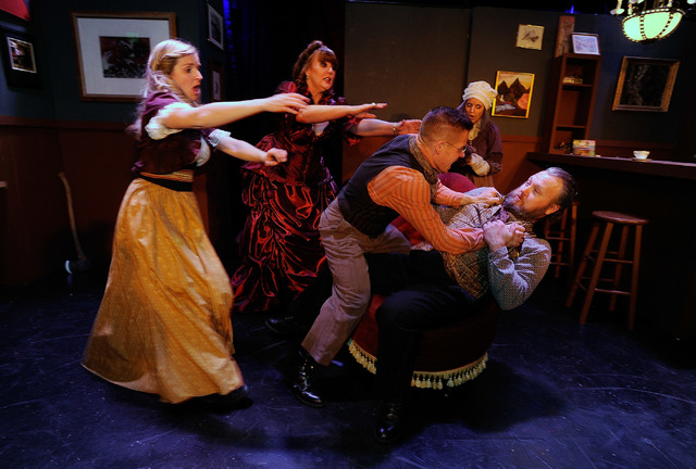 """Stacia Zinkevich, left, Kellie Wright, Brandon Burk, Taliesin McEnanui and TJ Larsen rehearse a scene in """"Anton Chekhov's 'Cherry Orchard of the Living Dead' """" at the Onyx Theatre. (David Becker/L ..."""