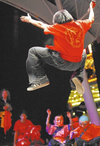 A performer from the Lohan School of Shaolin catches some air during the Chinese New Year celebration downtown. (JASON BEAN/LAS VEGAS REVIEW-JOURNAL