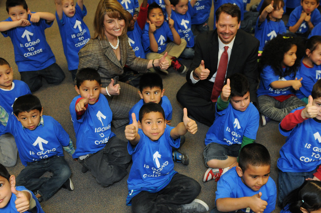 Clark County School District Superintendent Pat Skorkowsky, top right, and State Treasurer Kate Marshall, pose for photos with kindergarten students at Bracken Elementary School in Las Vegas durin ...