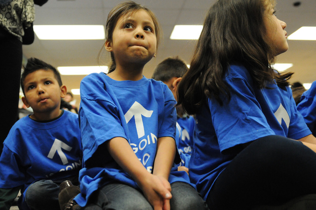 Kindergarten students at Bracken Elementary School in Las Vegas from left, Nestor Razo, Ashley Hernandez, and Jaret Reyes, sit in their school's library during a media conference to discuss the la ...