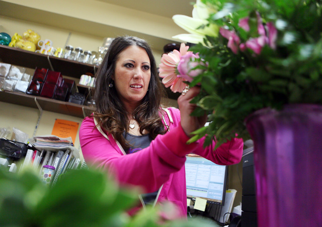 Nikki Hays, owner of A Country Rose, works on an arrangement at the flower shop in Henderson. (Ronda Churchill/Las Vegas Review-Journal)