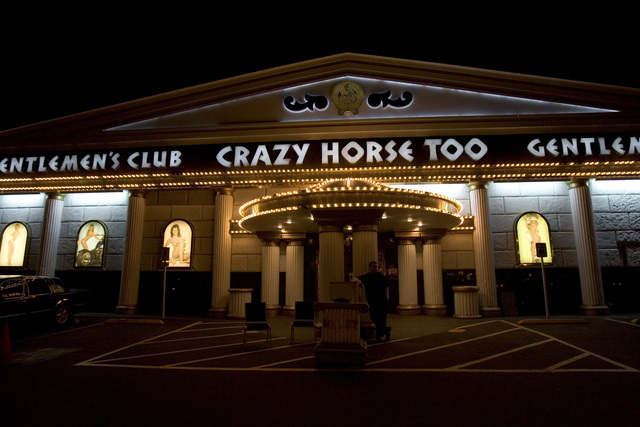 Crazy Horse Too valet Jason Harms waits for customers in this Wednesday, Oct. 18, 2006, file photo. The club reopened in 2013 with the name The Horse Gentleman's Club, but will be allowed to use ...
