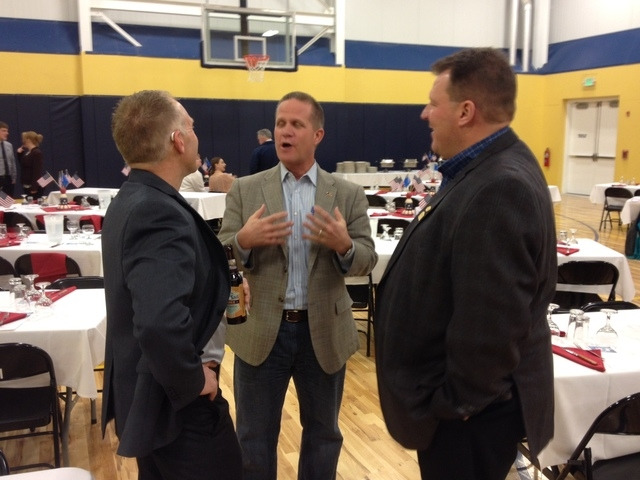 State Sen. Mark Hutchison talks with Andy Cole of Elko, left, and Roger Souckey of Barrick Mining at the Elko debate. (Sean Whaley/Review-Journal)